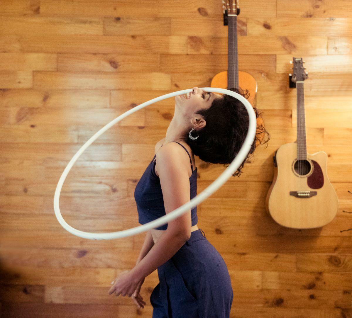 Hoop hula nose spinning wooden wall happy